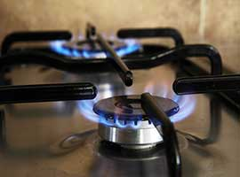 gas cooker rings with blue flames looking warm. heating and plumbers offer a full gas cooker installation and service
